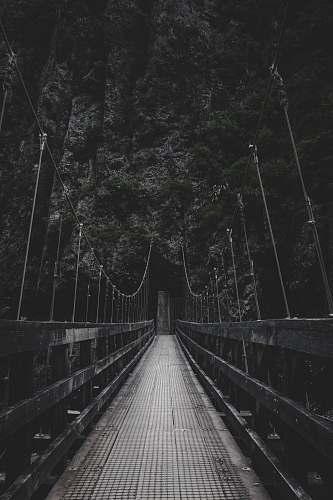 photo grey photo of bridge near mountain bridge free for commercial use images