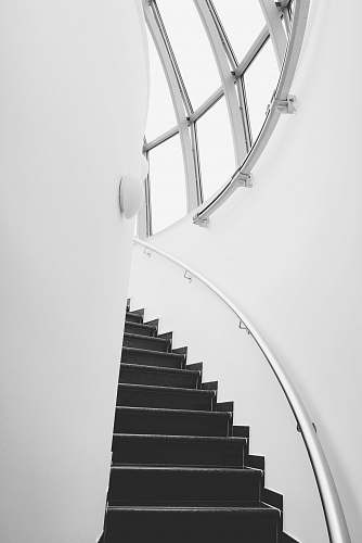 banister photo of stairway during daytime handrail
