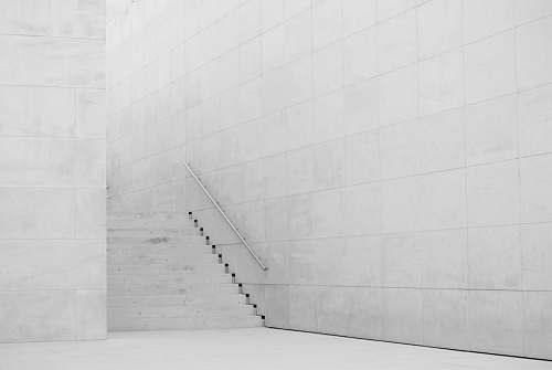 grey photography of white concrete stairs architecture