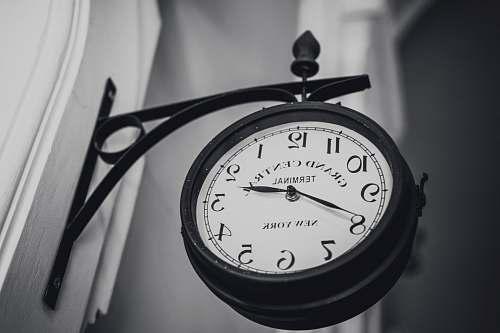grey round black wall clock wristwatch