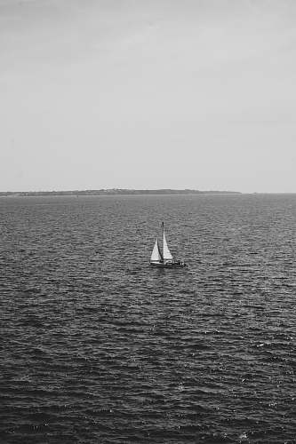 photo grey sailboat in sea transportation free for commercial use images