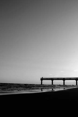 water silhouette of bridge pier