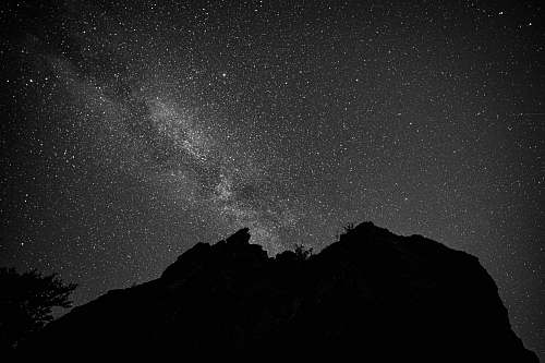 nature silhouette of mountain under starry night outdoors