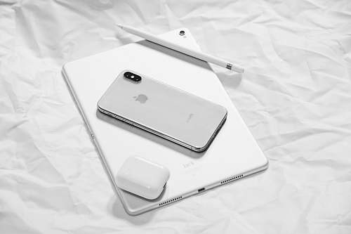 white silver iPhone X with silver iPad apple