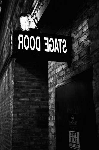 brick Stage Door signage building