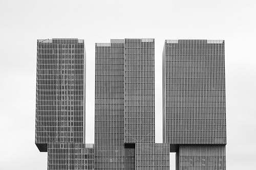 building three gray concrete high rise buildings architecture