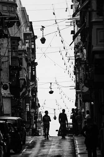 people two men walking on street during daytime human