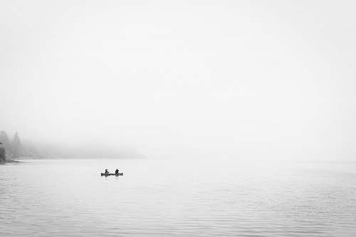 white two person in boat on body of water nature
