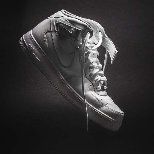 clothing unpaired white Nike low-top shoe apparel