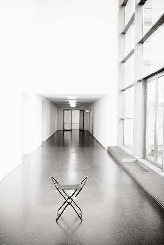 photo flooring vacant white chair in between hallway of building floor free for commercial use images