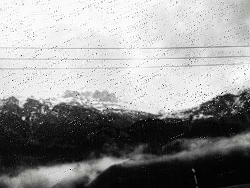 white view of mountains during a rainy weather rain