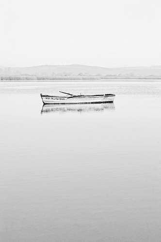 photo grey white and black boat on body of water transportation free for commercial use images