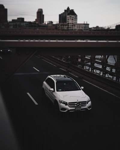 car white Mercedes-Benz SUV on road automobile