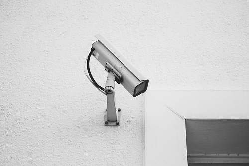 grey white security camera on white wall camera
