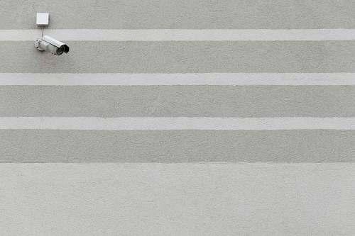grey white surveillance camera wall