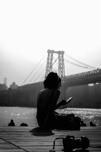human woman sitting on dock person
