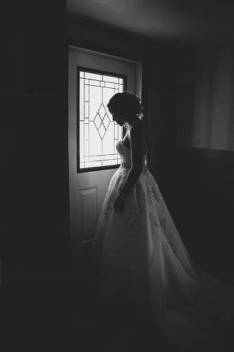 person woman standing behind the door human