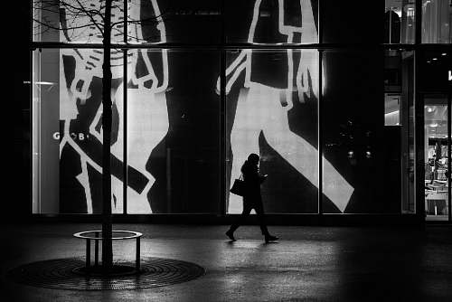 indoors woman walking near the gate interior design