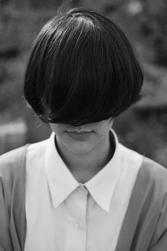 person woman with cropped hair covering her face human