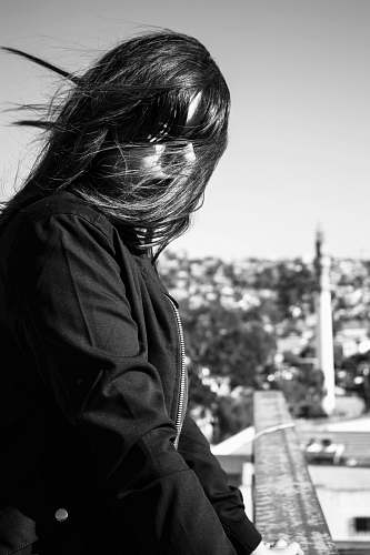 apparel woman's face covered with hair looking at her left during day clothing