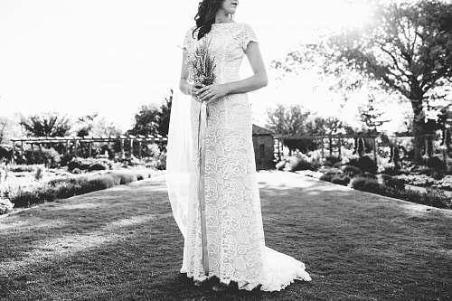 human women's white lace dress person
