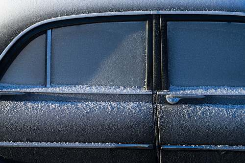 frost gray vehicle covered by snow car
