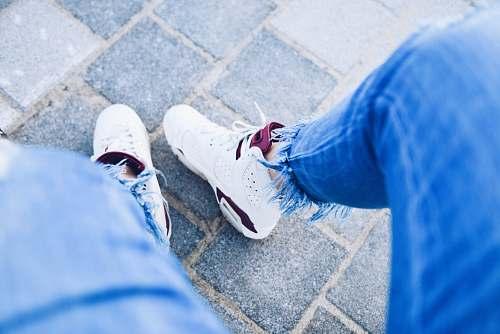 shoe person wearing pair of white Air Jordan 6's sneakers
