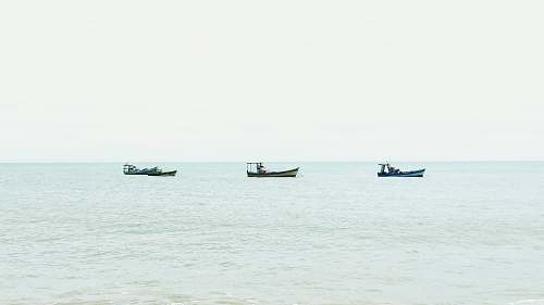 transportation three boats on body of water during daytime vehicle