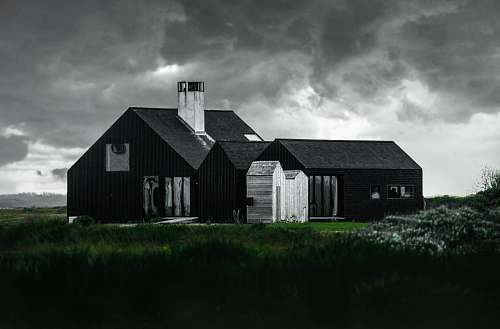 cloud black and white house beside green grass field rural
