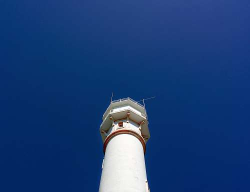 photo architecture closeup photo of white lighthouse beacon free for commercial use images