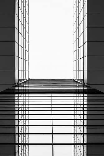 architecture gray and black building mirror black-and-white
