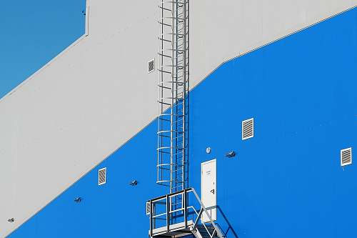 blue gray and blue building fire exit architecture