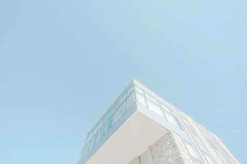architecture low angle photograph of white concrete building blue