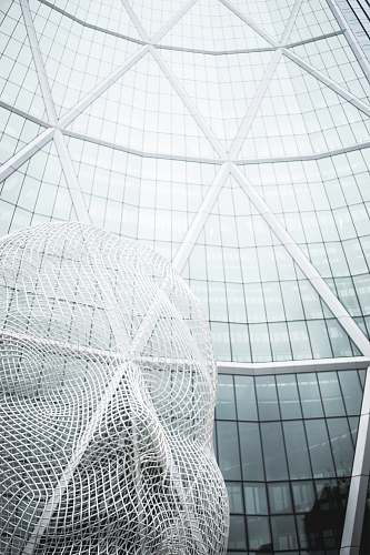 architecture low angle photography of glass building calgary