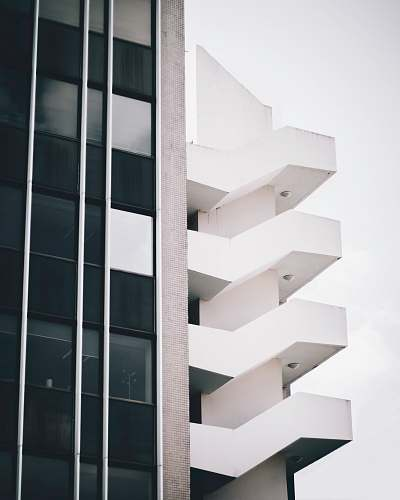 paris low angle photography of white high rise building aluminium