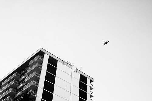 black-and-white low angle view photography of helicopter sky