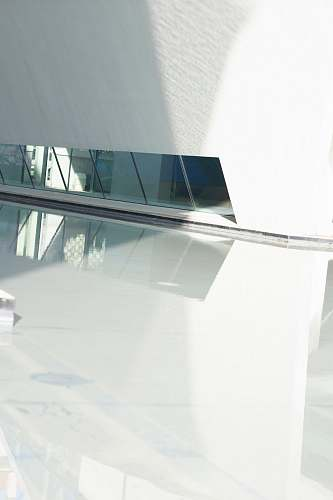 grey mirrors reflected on white polished floor architecture