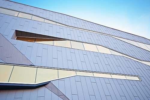 windows Modern building design with distinctive unique shaped glass windows city