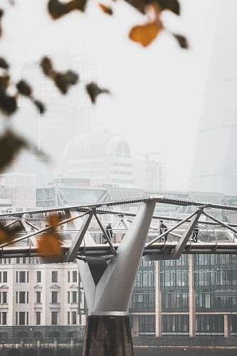 architecture photo of man walking on gray bridge london