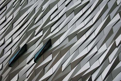 grey Undulating abstract shapes on a building facade at The Titanic Memorial Garden. pattern