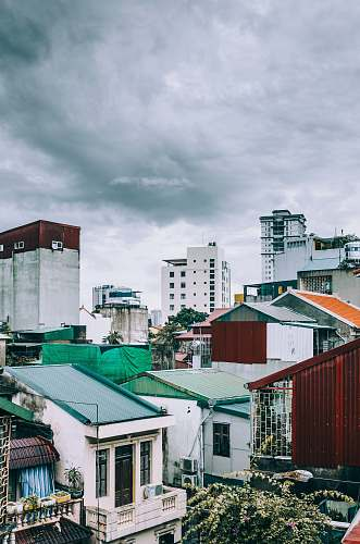 hanoi white and gray concrete mid-rise buildings under gray clouds vietnam