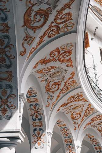 architecture white and orange floral ceiling arch