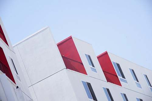 red white and red concrete building photo architecture