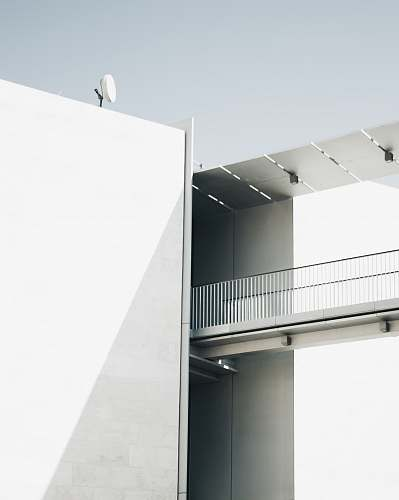 architecture white building under sky staircase