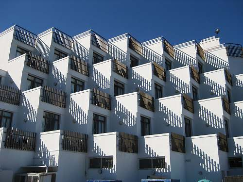 architecture white concrete houses under blue sky apartment building