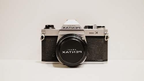 electronics round black and silver analog watch vintage pentax film camera