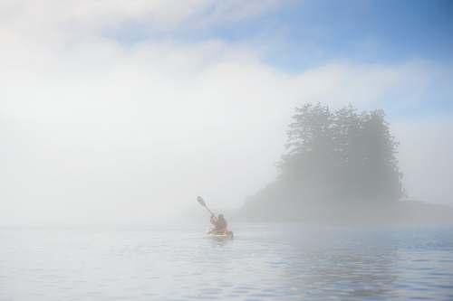 paddling person rowing boat in sea kayaking