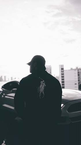 automobile grayscale photo of person wearing US Polo jacket transportation