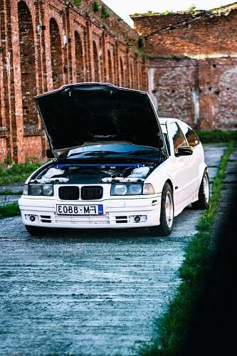 automobile white BMW car transportation