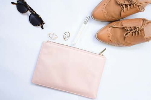 shoe oxford shoes, sunglasses, and wristlet accessories